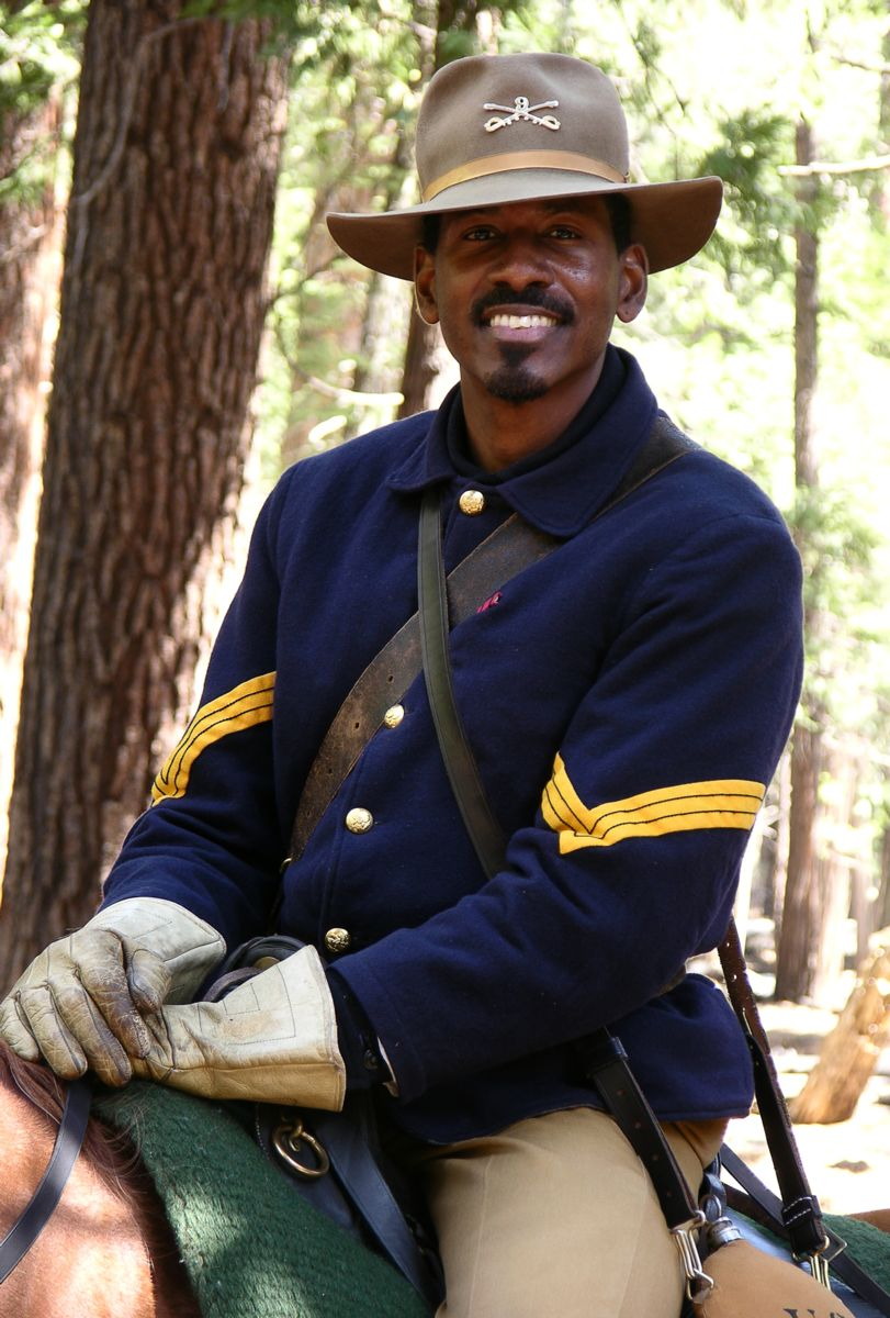 Ranger Shelton Johnson posing as Elizy Boman, a Buffalo Soldier who served in Yosemite National Park in 1903 and 1904. Photo Credit: NPS
